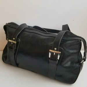 Etienne Signer black leather bag.